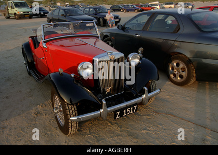Denmark Fano oldtimer cars parked on the beach during the traditional midsummer night bonfire held every year at - Stock Photo
