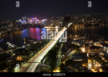 High level aerial oblique view at twilight night or dusk of Harbour Bridge in Sydney New South Wales NSW Australia - Stock Photo
