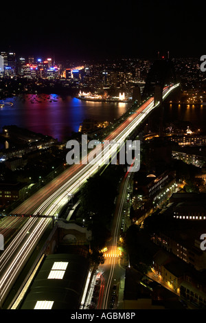 High level aerial oblique view at twilight night or dusk of Harbour Bridge with light trails in Sydney New South - Stock Photo