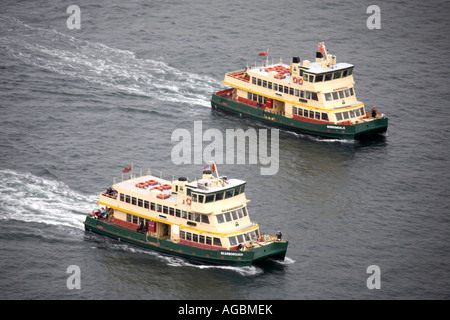 High level oblique aerial view of two ferry boats on the harbour in Sydney New South Wales NSW Australia - Stock Photo