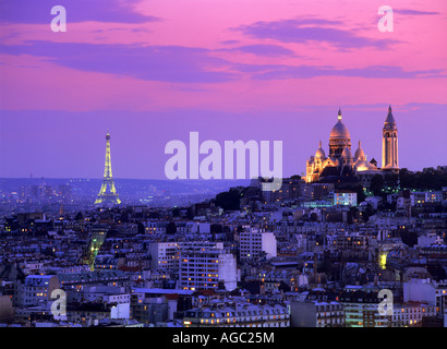 Sacre-Coeur and Eiffel Tower above Paris skyline at dusk - Stock Photo