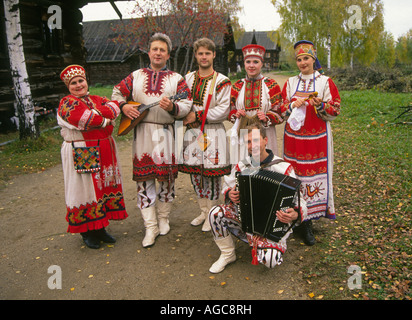 A group of Russian musicians dressed in traditional clothing in a small remote village on the banks of the legendary - Stock Photo