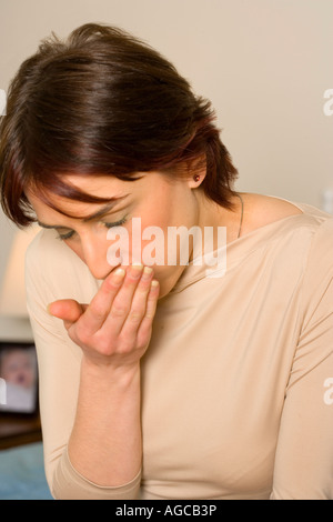 Woman with COPD ( Chronic Obstructive Pulmonary Disease) coughing. - Stock Photo