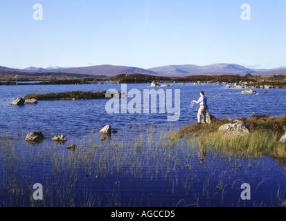 dh Lochan na h Achlaise RANNOCH MOOR ARGYLL Angler casting fishing line freshwater lake mountainous wetland terrain