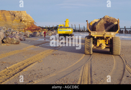 REPAIRNG SEA DEFENCES AT HAPPISBURGH  WITH ROCKS NORFOLK EAST ANGLIA ENGLAND UK - Stock Photo
