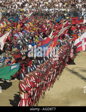 The colourful parade of the Calcio Storico in the Piazza Santa Croce, Florence, Italy. - Stock Photo