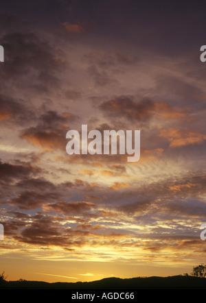 dh  KILMARTIN ARGYLL Kilmartin valley sunset pink orange grey clouds and purple sky