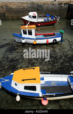 Colourful fishing boats in Portreath Harbour Cornwall UK - Stock Photo