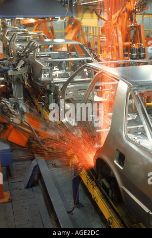 Sparks flying from robatic spot welding at SAAB Scania plant in Sweden - Stock Photo