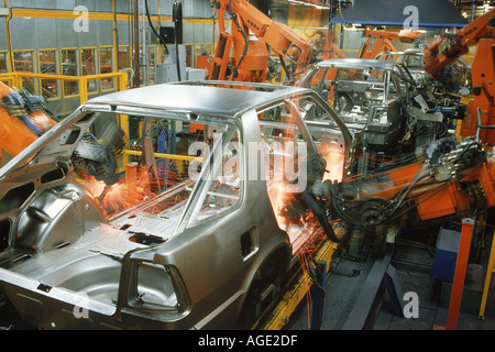 Sparks flying from spot welding robotics in SAAB Scania plant in Sweden - Stock Photo