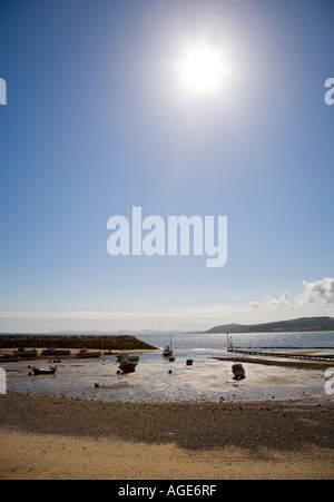 Boats on the beach at low tide Rhos on Sea Conwy Wales UK - Stock Photo