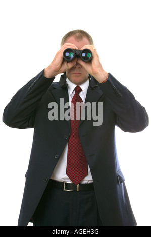 Businessman using a pair of binoculars - Stock Photo