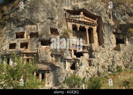 Ancient Lycian Rock Cut Tombs Above the Town of Fethiye, Turqoise Coast, Near Dalaman, Turkey - Stock Photo