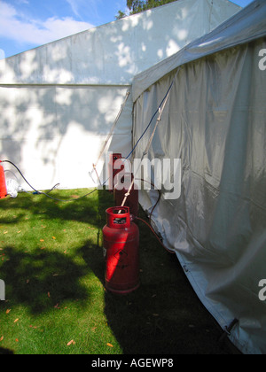 White Marquee with Sides Closed in Garden in Northumberland Prior to Wedding Reception - Stock Photo