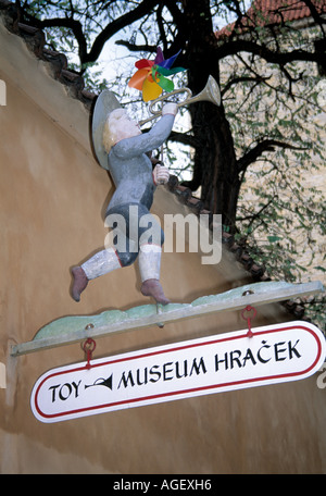 carved wooden figure at the  entrance to a  toy museum, prague castle czech republic figure, - Stock Photo