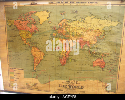 Old school world wall map showing British Empire in red - Stock Photo