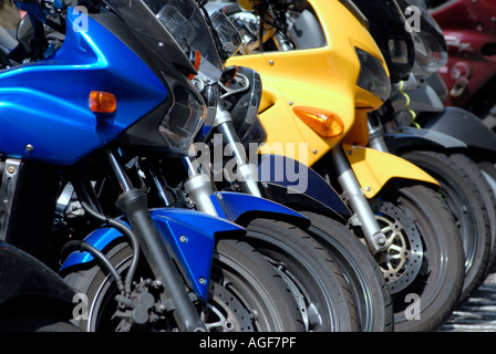 Motorcycles parked in a London street - Stock Photo