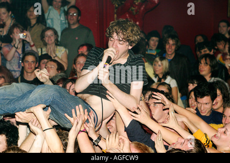 Lead singer from The Others crowd surfing at Club NME at Koko in Camden London - Stock Photo