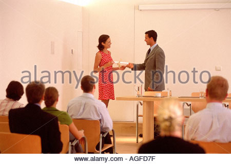 Woman presented a certificate - Stock Photo