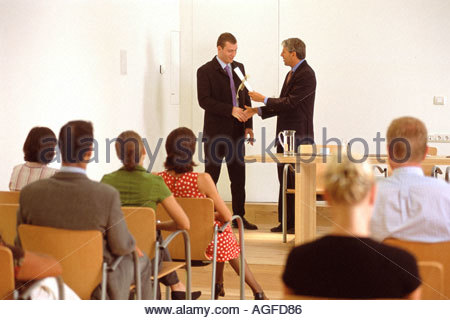 Man presented with certificate - Stock Photo