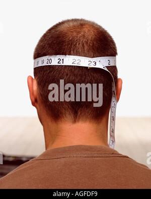 Measuring male head - Stock Photo