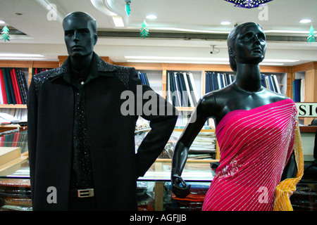 7b9697398cf ... Male and female mannequins dressed up in party wear in a shopping mall  in Kerala,