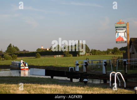 Traditional canal narrowboat at sunset on the Grand Union Canal - Stock Photo