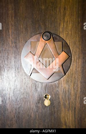 brass door knocker masonic symbols compass square inside a masonic lodge freemason freemasonry freemason secret - Stock Photo