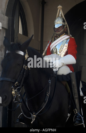 A member of the Life Guards of the Household Cavalry sits on his horse at the entrance to the Horseguards building. - Stock Photo