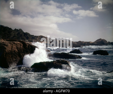 Point Lobos State Reserve on the Monterey Peninsula of California showing rough surf crashing onto a rocky headland - Stock Photo