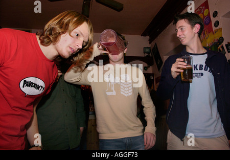 Students at Aberystwyth University drinking jugs of lagar at The Glengower club in the town - Stock Photo