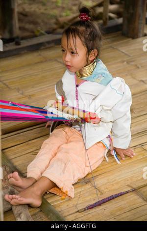 Child wearing neck rings..Lahu Shi Balah Hill Tribe Thailand - Thai hilltribe- Karen long necks Thaton, Ecotourisim - Stock Photo