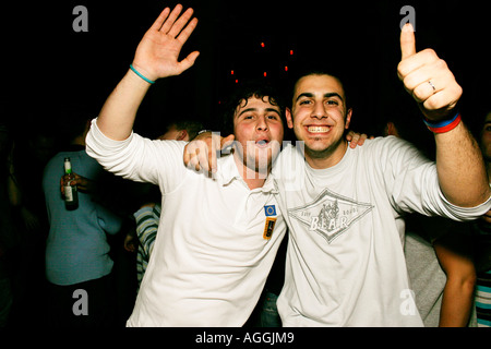 Two mates having a night out at Club Zoo in Warsaw Poland - Stock Photo