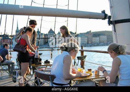 people in restaurant onboard main tourist attraction - the historic ship Af Chapman, Skeppsholmen, Stockholm, Sweden - Stock Photo
