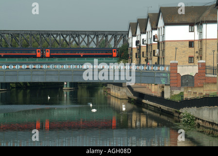 Peterborough train at speed crossing bridge over River Nene - Stock Photo