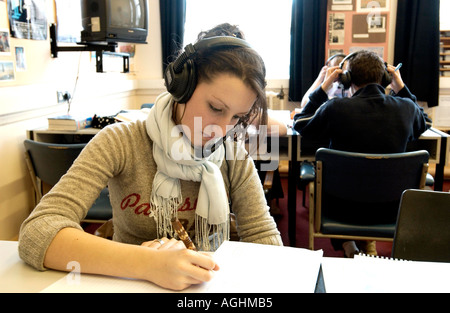 A  teenage girl in a language laboratory concentrating on an AS  Spanish lesson - Stock Photo