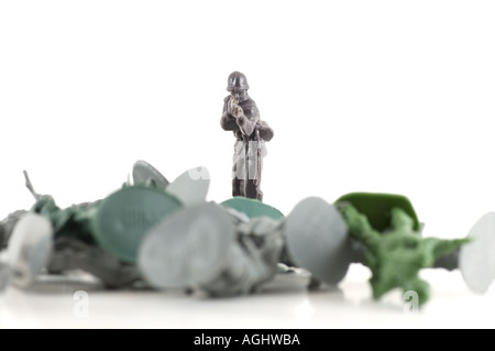 Brown toy soldier stands guard over the enemy - Stock Photo