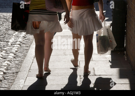 Girls walking on the south bank of the Thames in London - Stock Photo
