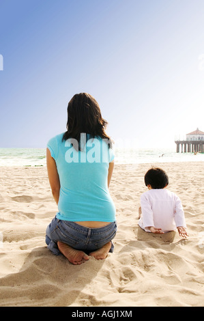 Mother and Son Sitting on Beach - Stock Photo
