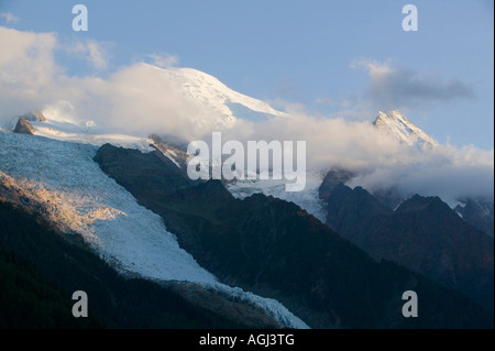 Late evening light falling on Seracs on Mont Blancs Bossons glacier which is retreating rapidly due to global warming - Stock Photo
