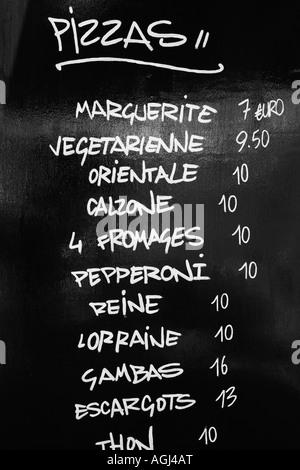 Close-up of a menu list on a blackboard - Stock Photo