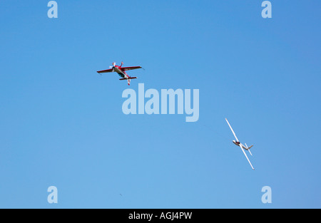 S-1 Swift glider and Extra 300L tow plane performing aerobatic manoeuvres at Shoreham Airshow, Shoreham airport, - Stock Photo