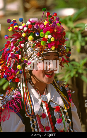 China Yunnan Xiao Hu La village Akha Hani woman in traditional festival costume - Stock Photo