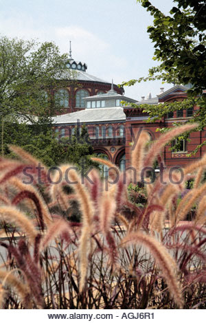 View of the Smithsonian Institution Arts and Industries Building through ornamental grass in Washington DC - Stock Photo