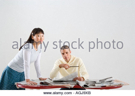Young professionals with newspapers - Stock Photo