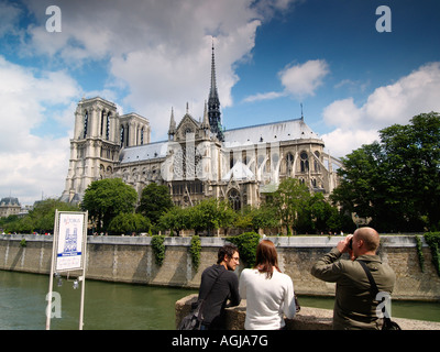 Tourists at the Notre Dame cathedral in Paris France - Stock Photo