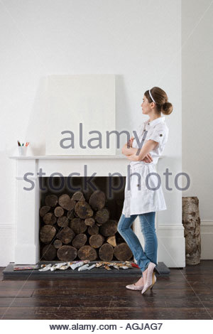 Young artist looking at blank canvas - Stock Photo