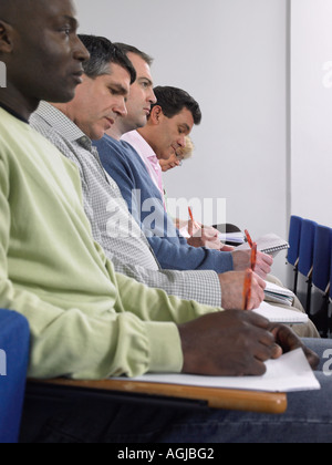 Mature students in a lecture - Stock Photo
