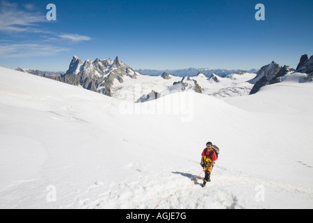Climbers descending from the summit of the 4000m peak of Mont Blanc du Tacul - Stock Photo