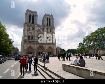 Lots of people tourists in front of the famous Notre Dame cathedral in Paris France - Stock Photo